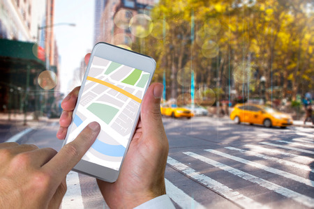 taxi: Man using map app on phone against blurry new york street