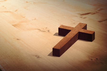 bleached: Wooden cross against bleached wooden planks background