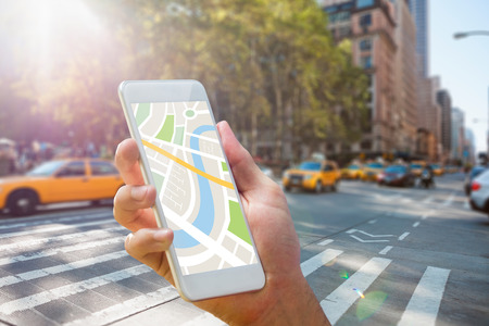 taxi cab: Man using map app on phone against new york street
