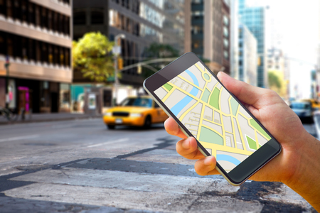 new york map: Man using map app on phone against new york street