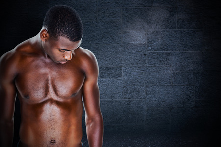 young adult men: Fit shirtless young man against black background