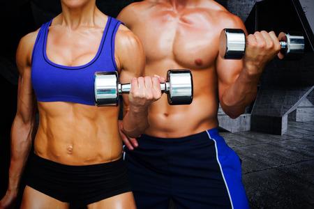 pesas: Culturismo pareja contra el cuarto oscuro