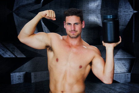 powder room: Bodybuilder with protein powder against dark room