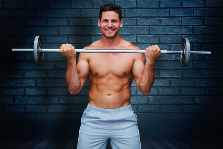 lean out: Handsome bodybuilder against black background Stock Photo
