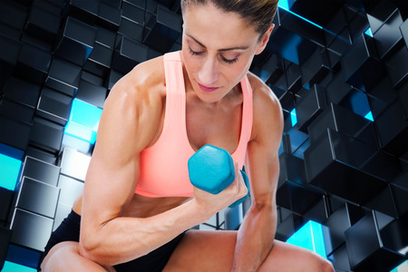 lean out: Strong woman doing bicep curl with blue dumbbell against blue and black tile design