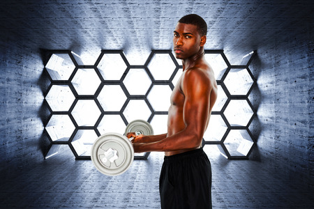 abdominal wall: Portrait of a serious fit young man lifting barbell against hexagon room