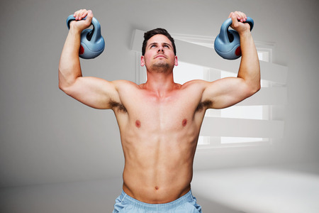 bordered: Bodybuilder holding kettlebells against digitally generated room with bordered up window