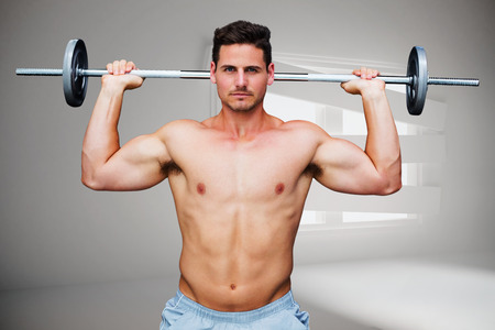 bordered: Bodybuilder lifting barbell against digitally generated room with bordered up window