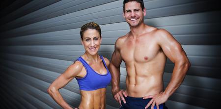 shutters: Bodybuilding couple against grey shutters