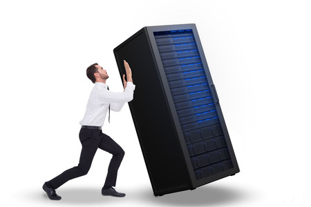 bent: Businessman standing with bent legs and pushing against server tower