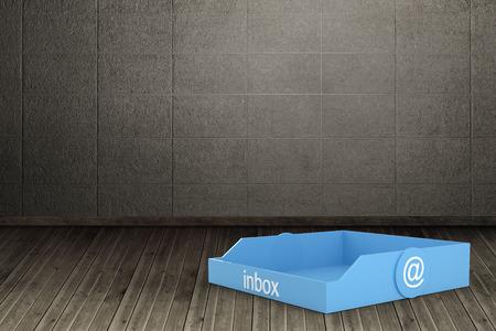 floorboards: Blue inbox against dark room with floorboards