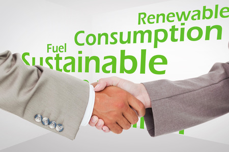 nonpolluting: Side view of shaking hands against creative image of green economy concept Stock Photo