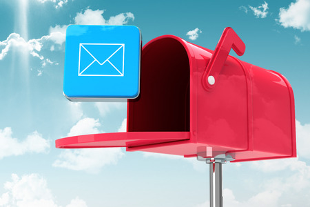Red email postbox against blue sky