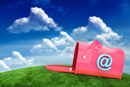 post box: Red email post box against green field under blue sky Stock Photo