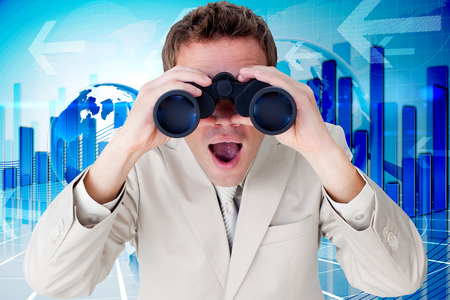 using binoculars: Positive businessman using binoculars against global business graphic in blue
