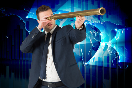 viewing: Businessman looking through telescope against global business graphic in blue Stock Photo