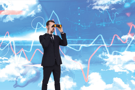 using binoculars: Elegant businessman standing and using binoculars  against blue sky Stock Photo