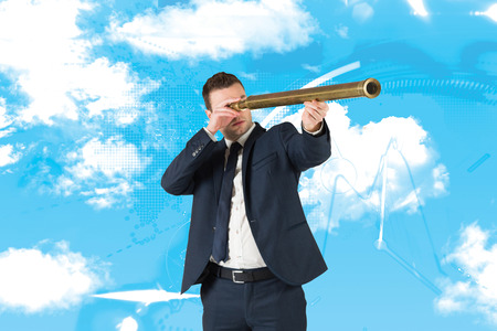 stocks and shares: Businessman looking through telescope against stocks and shares Stock Photo