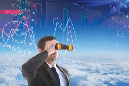 digital stock: Young businessman looking through binoculars against stocks and shares