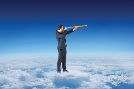 altitude: Businessman looking through telescope against blue sky over clouds at high altitude