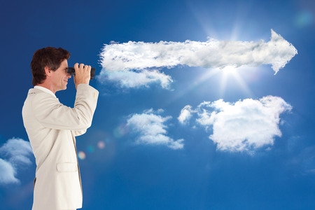 using binoculars: Businessman using binoculars against cloud arrow Stock Photo