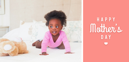 babygro: mothers day greeting against baby girl in pink babygro crawling on bed Stock Photo