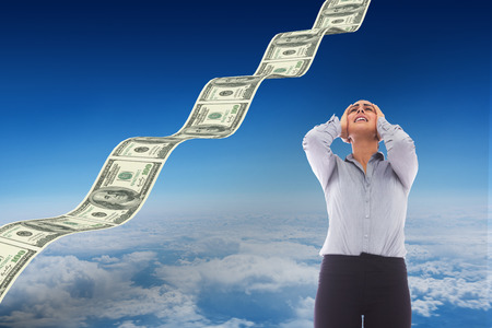 altitude: Desperate businesswoman against blue sky over clouds at high altitude Stock Photo