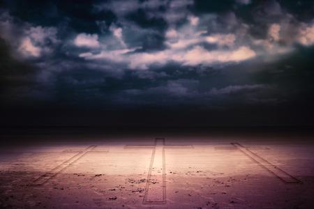 Cross against dark cloudy sky