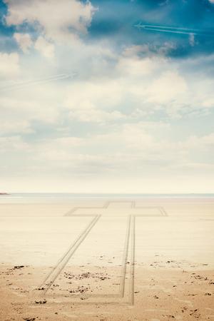 beach landscape: Cross against serene beach landscape