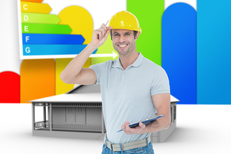 ber: Architect wearing hard hat while holding clip board against house with energy rating background Stock Photo