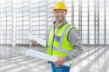 building safety: Happy architect against room with large window overlooking city Stock Photo