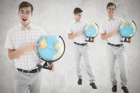 cheesy grin: Nerd with globe against white and grey background