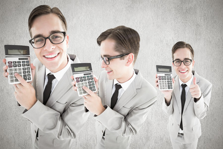 Nerd with calculator against white and grey background photo