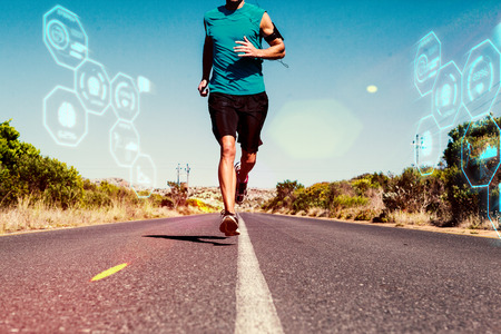 against: Athletic man jogging on open road against fitness interface
