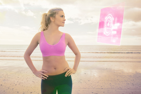 hacer footing: Toned woman with hands on hips on beach against fitness interface