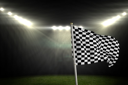 football pitch: Checkered flag against football pitch under bright spotlights