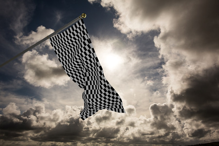 checker flag: Checkered flag against dark sky with white clouds