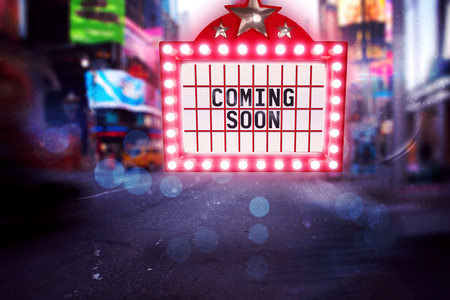 coming soon: Neon coming soon sign against blurry new york street Stock Photo