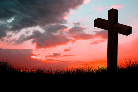 red sky: Wooden cross against red sky over grass