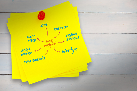 red pushpin: Diet plan against sticky note with red pushpin