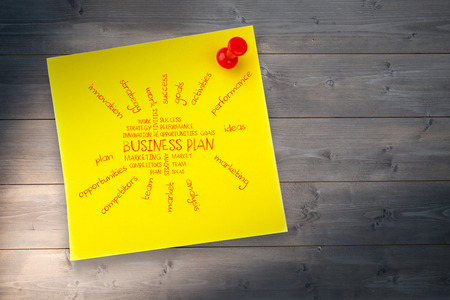buzz word: Business plan against yellow pinned adhesive note Stock Photo