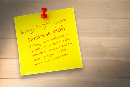 buzz word: Business plan against pinned adhesive note