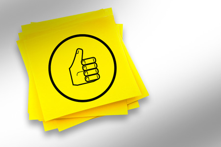 page down: Thumbs up graphic against sticky note Stock Photo