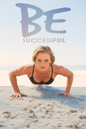 plank position: Fit blonde in plank position on the beach against be succesful