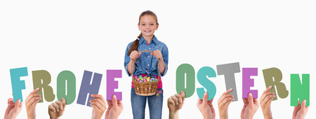 Ostern: Hands holding up frohe ostern against portrait of a girl holding a basket full of easter eggs