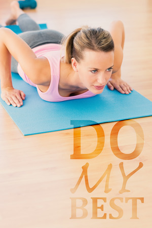 ups: Determined beautiful woman doing push ups against do my best Stock Photo