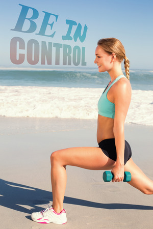 weighted: Fit woman doing weighted lunges on the beach against be in control Stock Photo