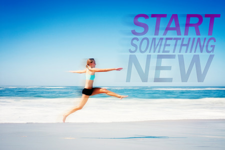 something athletic: Fit woman jumping gracefully on the beach  against start something new