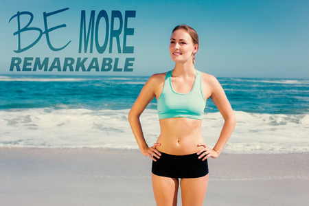 remarkable: Fit woman standing on the beach with hands on hips against be more remarkable