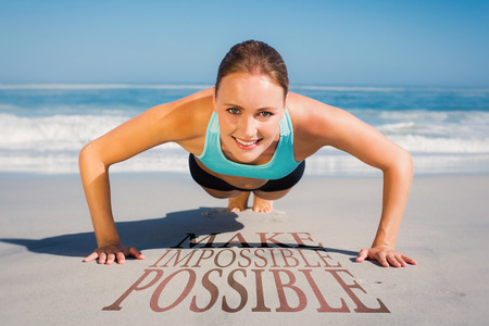 plank position: Fit woman in plank position on the beach against make impossible possible Stock Photo